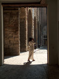 Woman in white. In doorway in florence italy Royalty Free Stock Images