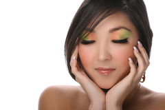 Woman on white. Attractive young woman with colorful makeup isolated on white Stock Photos