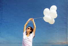 Woman with white balloons Royalty Free Stock Photos