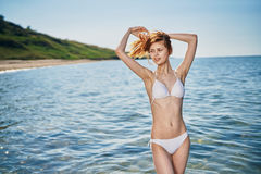 Woman in a white bathing suit on the beach of the sea, summer, vacation, sun Stock Images