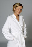 Woman in White Bathrobe. Young Woman in White Bathrobe Royalty Free Stock Image