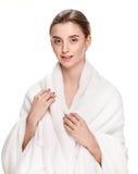 Woman in white bathrobe Stock Photography