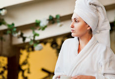Woman in white bathrobe and towel Stock Images