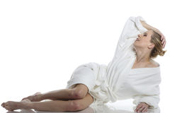 Woman in white bathrobe Stock Photos