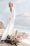 Woman in white on the beach Stock Photo