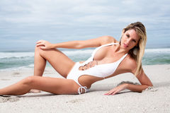 Woman in white bikini Stock Photos