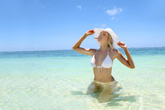 Woman in white bikini Stock Photo