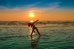 Woman in white bikini posing in a sea Royalty Free Stock Photography