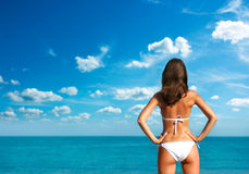 Woman in White Bikini at the Sea. Rear View. Stock Image