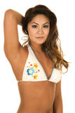 Woman in white bikini standing with arm behind her head upper bo Stock Images