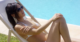 Woman in white bikini wearing sunglasses Royalty Free Stock Photography
