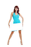 Woman with white blank. The girl in a  blue dress holds blank for advertising Stock Photography