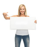 Woman with white blank board. Woman pointing her finger at white blank board Stock Image
