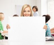 Woman with white blank board at school Stock Photos