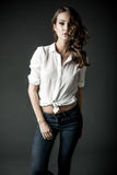 Woman in white blouse and blue jeans Royalty Free Stock Photos