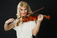 Woman in White Blouse Playing Violin Stock Photo