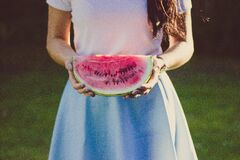 Woman in White and Blue Dress Holding Water Melon Royalty Free Stock Photography
