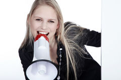 Woman on white board with megaphone Royalty Free Stock Photos