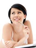 Woman in white bra makes some notes Royalty Free Stock Photos