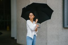 Woman in White Button-up Long-sleeved Shirt Holding Black Umbrella royalty free stock images