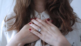Woman in White Button Up Shirt and Red Manicure With Silver Ring Royalty Free Stock Photography