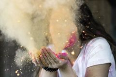 Woman in White Cap-sleeved Shirt Blowing Dust Stock Images