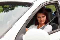 Woman in a white car Stock Photo