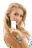 Woman with white cardboard Stock Image