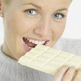 Woman with white chocolate Royalty Free Stock Images