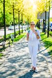 Woman in white in the city Stock Photos