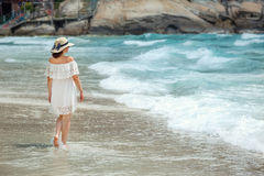 Woman with white clothe walking on the beach Royalty Free Stock Photography