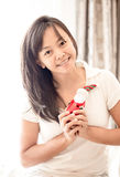 Woman in white clothes holding toy of Santa in hand Royalty Free Stock Image