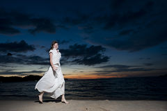 Woman in white clothing Stock Photos