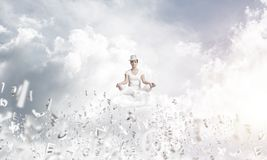 Young woman keeping mind conscious. Royalty Free Stock Images