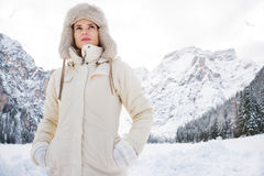 Woman in white coat and fur hat standing in winter outdoors Stock Photography