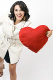 Woman with white coat with red heart Royalty Free Stock Photography