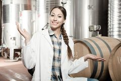 Woman in a white coat on the winery. Of spain stock images