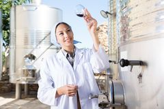 Woman in white coat on the winery. Of spain stock images