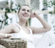 Woman in white with coffee Royalty Free Stock Image