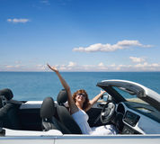 Woman in a white convertible royalty free stock image