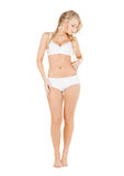 Woman in white cotton underwear checking fat level. Health and beauty concept - beautiful woman in white cotton underwear checking fat level stock image