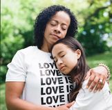 Woman in White Crew-neck T-shirt Hugging Woman Shallow Focus Photography stock photography