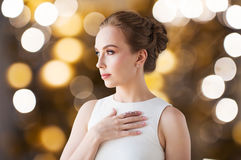 Woman in white with diamond ring and earring Royalty Free Stock Photo