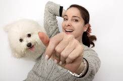 Woman with a white dog bichon frise. Woman with an adult dog bichon frise looking at camera high view Stock Image