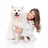 Woman with white dog, smiling Royalty Free Stock Photos