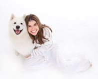 Woman with white dog, smiling, looking up Royalty Free Stock Photography