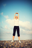 Woman in white doing yoga and sport exercises Stock Photos