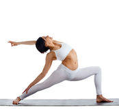 Woman in white doing yoga - warrior asana isolated Royalty Free Stock Images