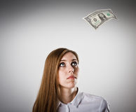 Woman in white and dollar. Royalty Free Stock Photo