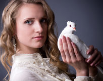 Woman with white dove Stock Photos